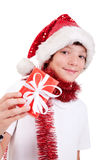 Menino bonito do Natal com um presente vermelho Imagens de Stock Royalty Free