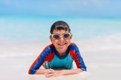 Menino bonito na praia Fotos de Stock Royalty Free