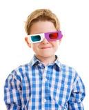 Menino bonito que desgasta os vidros 3D Fotografia de Stock Royalty Free