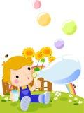 Menino bonito que joga bolhas Imagens de Stock