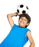 Menino bonito que joga o futebol Fotografia de Stock Royalty Free