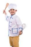 Menino chinês asiático nas ferramentas brancas de Uniform Holding Baking do cozinheiro chefe foto de stock
