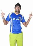 Menino cingalês da equipe do grilo Imagens de Stock Royalty Free
