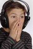 Menino com auriculares fotos de stock royalty free