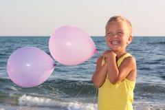 Menino com balões. Imagens de Stock
