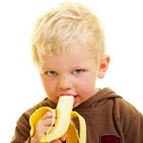 Menino com banana Fotos de Stock Royalty Free