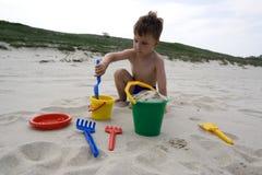 Menino com brinquedos Fotografia de Stock
