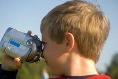 Menino com câmara de vídeo Foto de Stock Royalty Free