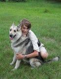 Menino com cão Imagem de Stock