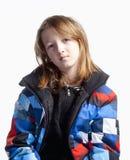 Menino com cabelo longo no revestimento colorido Imagens de Stock Royalty Free