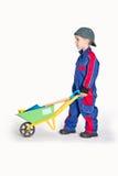 Menino com carrinho de mão Fotografia de Stock