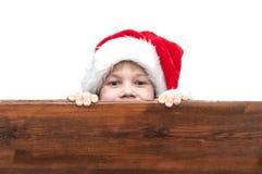 Menino com chapéu de Papai Noel Imagens de Stock