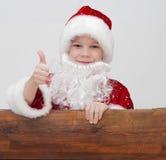 Menino com chapéu de Papai Noel Imagem de Stock Royalty Free