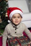 Menino com chapéu de Santa Fotografia de Stock Royalty Free
