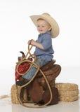 Menino com chapéu e sela Fotografia de Stock