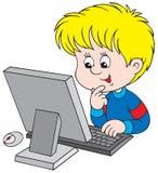 Menino com computador Fotografia de Stock Royalty Free