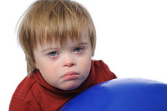 Menino com Down Syndrome Fotos de Stock
