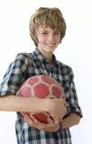 Menino com esfera de futebol Imagens de Stock