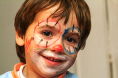 Menino com face pintada Foto de Stock Royalty Free