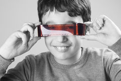 Menino com filme Imagens de Stock