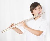 Menino com flauta Fotos de Stock