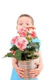 Menino com flor potted fotografia de stock