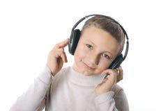 Menino com fones de ouvido Fotos de Stock Royalty Free