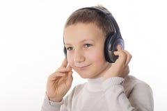 Menino com fones de ouvido Imagem de Stock Royalty Free