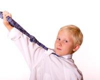 Menino com gravata que finge ser adulto Fotografia de Stock Royalty Free
