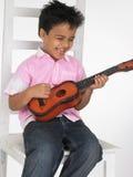 Menino com guitarra Imagens de Stock Royalty Free