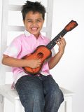 Menino com guitarra Imagem de Stock Royalty Free