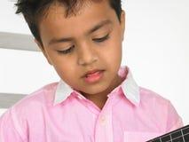 Menino com guitarra Fotografia de Stock