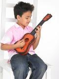 Menino com guitarra Foto de Stock Royalty Free