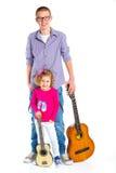 Menino com a guitarra espanhola clássica Foto de Stock Royalty Free