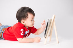 Menino com iPad Imagem de Stock
