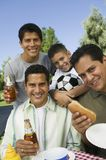 Menino com irmãos e pai Foto de Stock Royalty Free