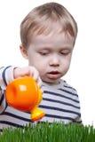 Menino com lata molhando Foto de Stock Royalty Free