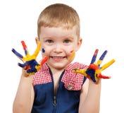 Menino com mãos pintadas Fotos de Stock
