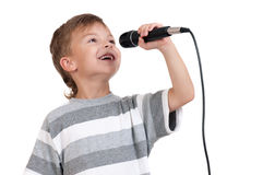 Menino com microfone Foto de Stock Royalty Free