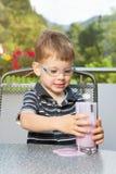 Menino com milk shake Imagem de Stock Royalty Free
