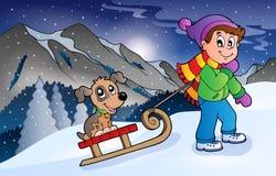 Menino com o cão no pequeno trenó no inverno Imagem de Stock Royalty Free