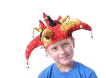 Menino com o chapéu vermelho do Natal Imagens de Stock