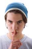 Menino com o dedo na boca Fotografia de Stock