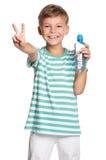 Menino com o frasco da água Imagens de Stock