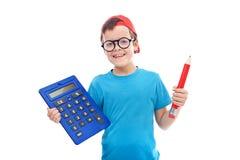 Menino com o grandes calculadora e lápis Imagens de Stock Royalty Free