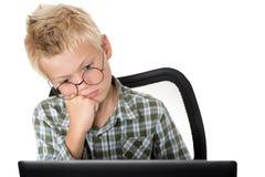 menino com o portátil Fotografia de Stock Royalty Free