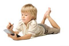 Menino com PDA Imagens de Stock