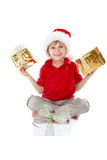 Menino com presentes de Natal Fotografia de Stock Royalty Free
