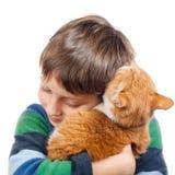 Menino com seu gato fotografia de stock royalty free