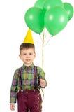 Menino com tampão e balões do aniversário Foto de Stock Royalty Free